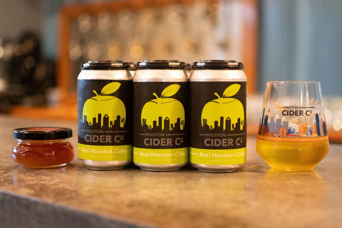 honey jar, cider cans, cider in glass