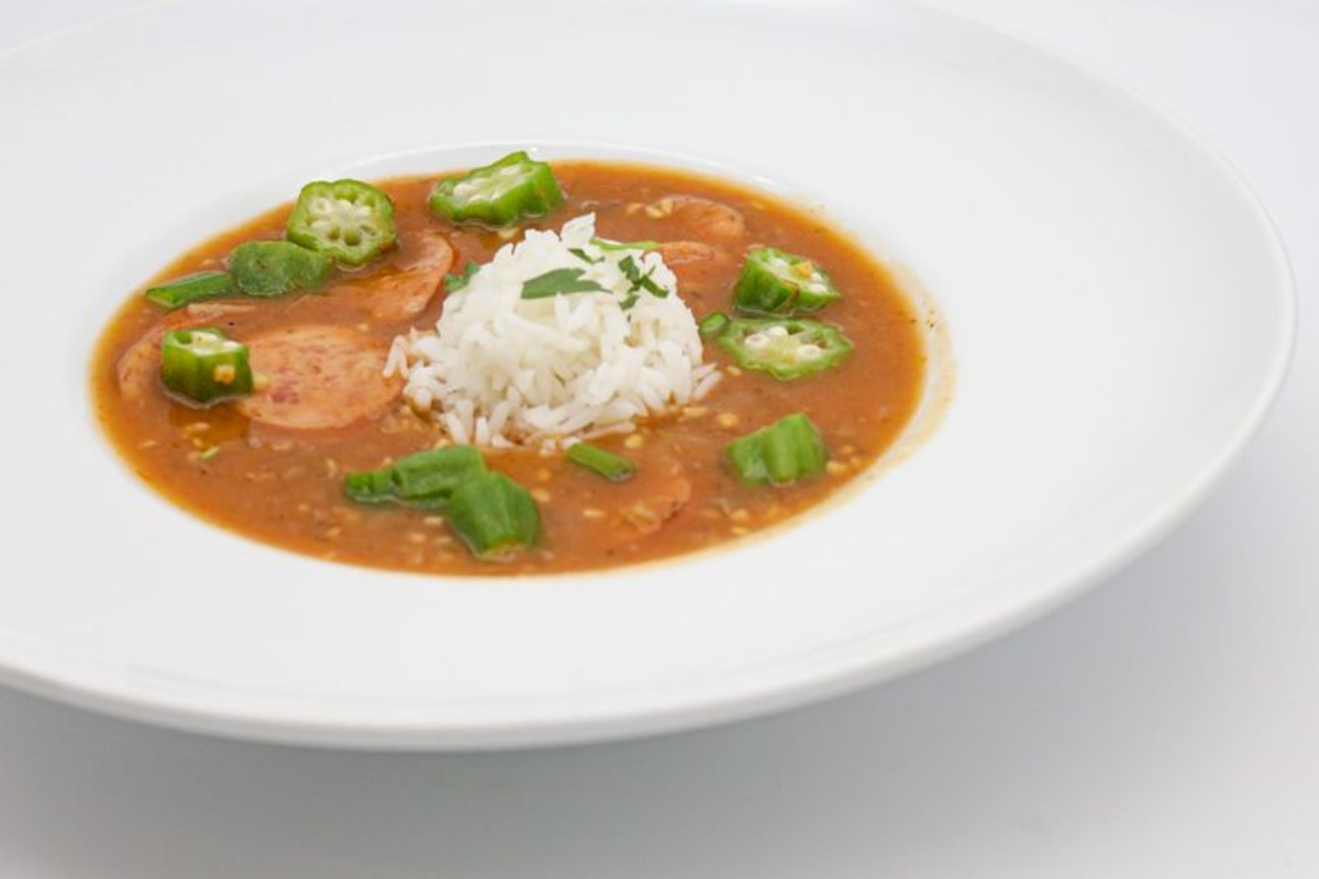 Bowl of gumbo with sausage, okra and a scoop of white rice