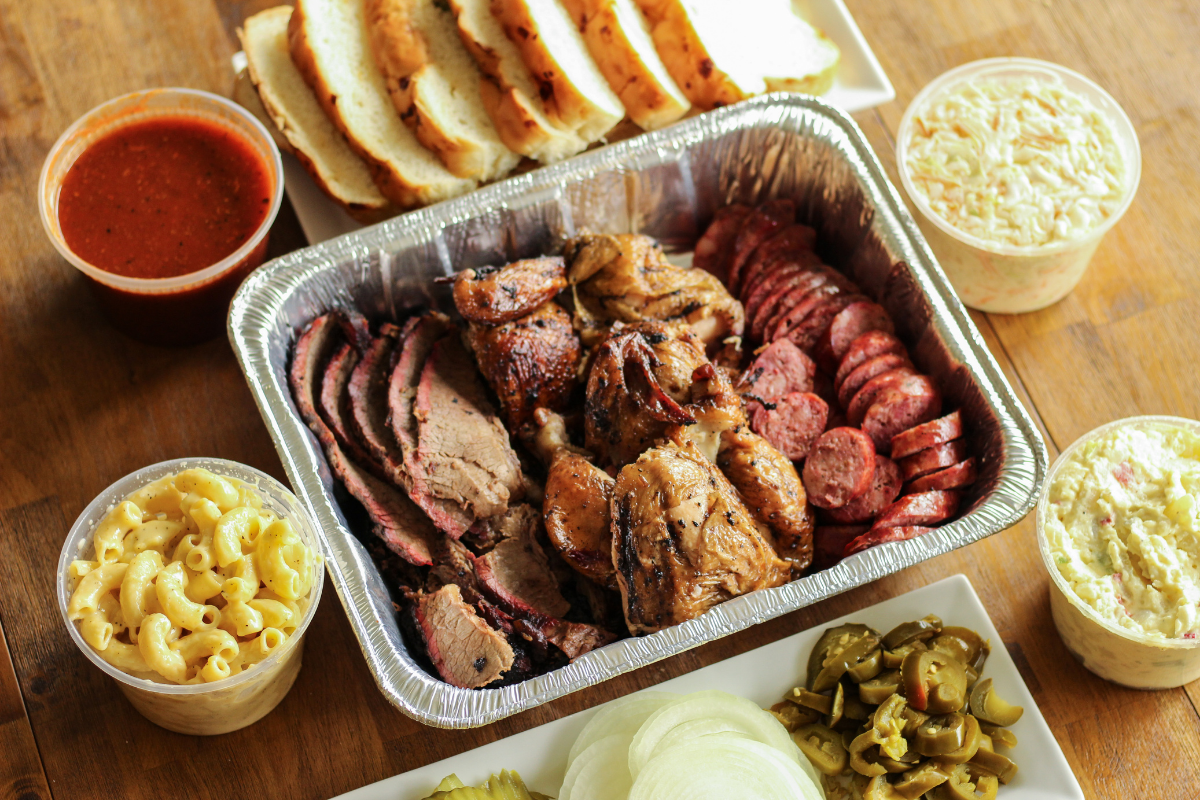 baking tray of barbecue and sides