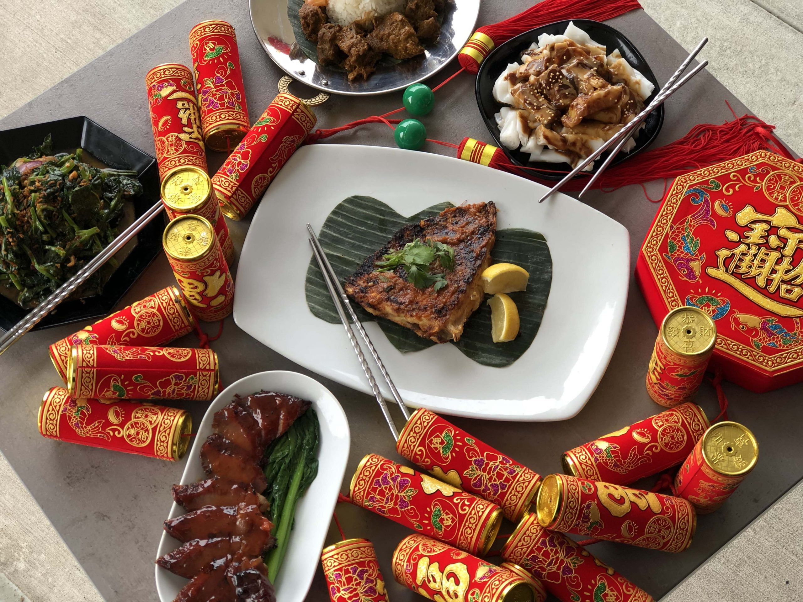 Overhead view of Malaysian food with Chinese decorations