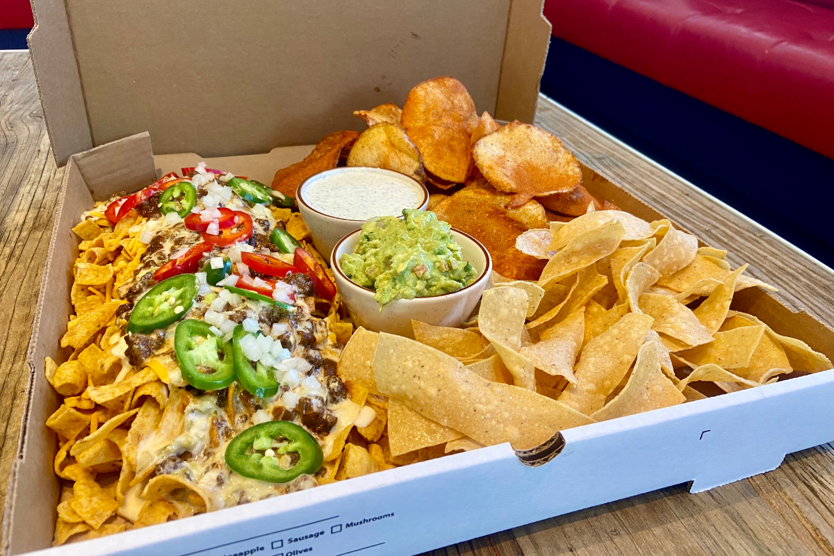 pizza box of Frito pie, chips and dips