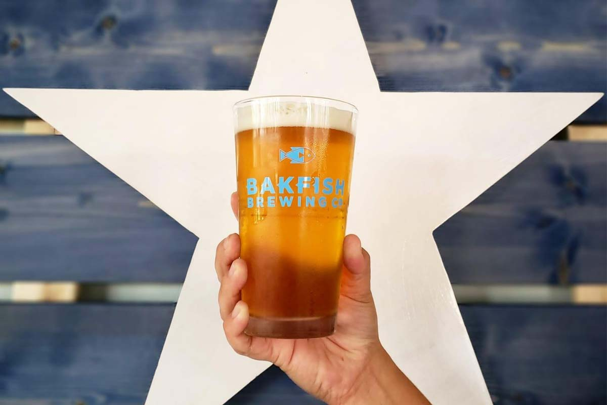 pint of beer held up in front of a large star background