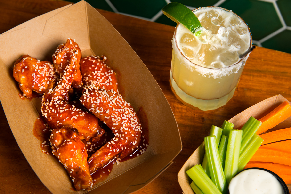 Basket of wings and a margarita