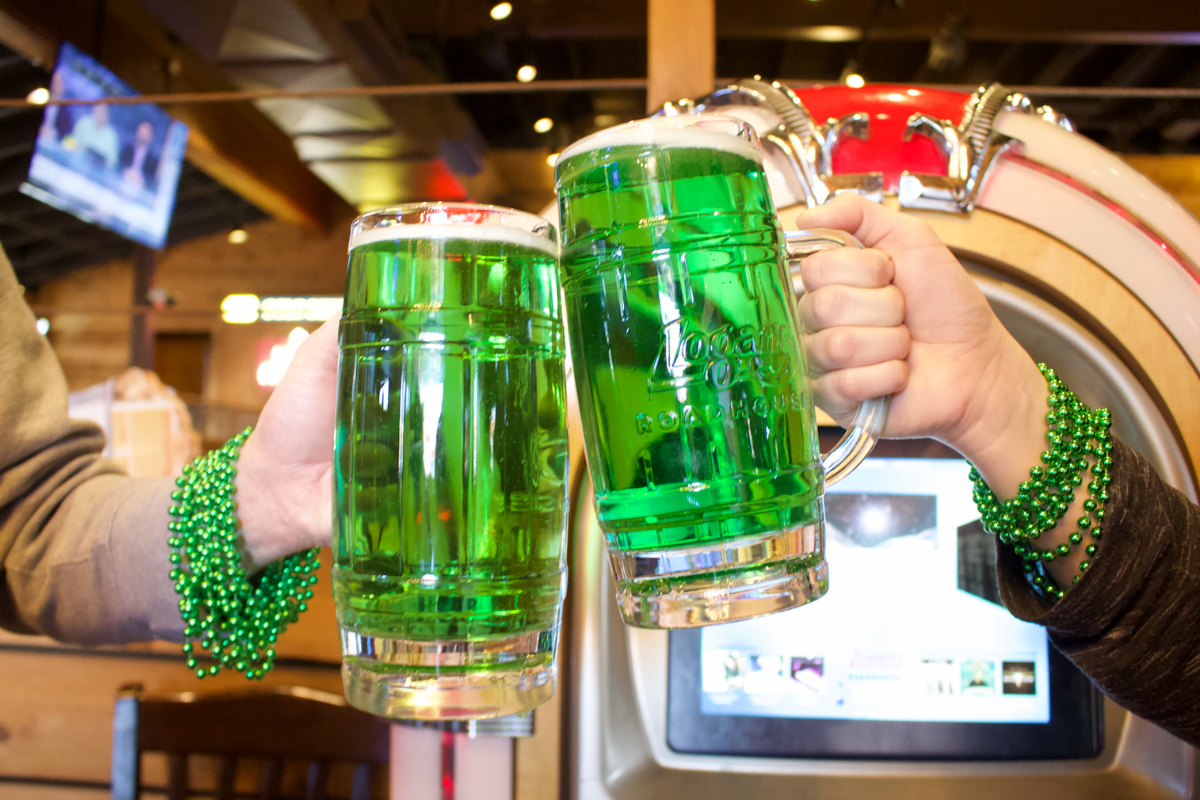 two steins of green beer