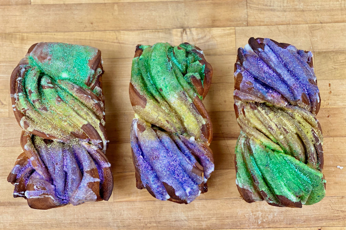 overhead view of three mardi gras theme loaves