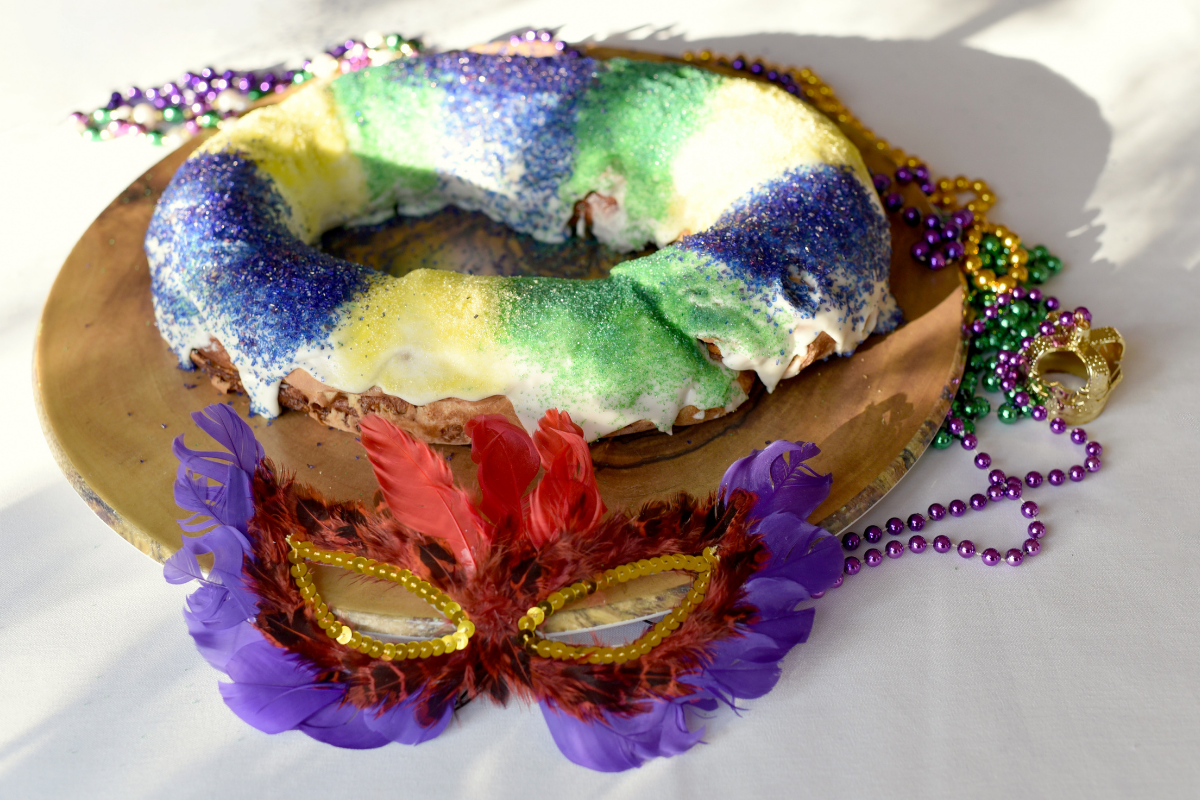 king cake with mask and beads