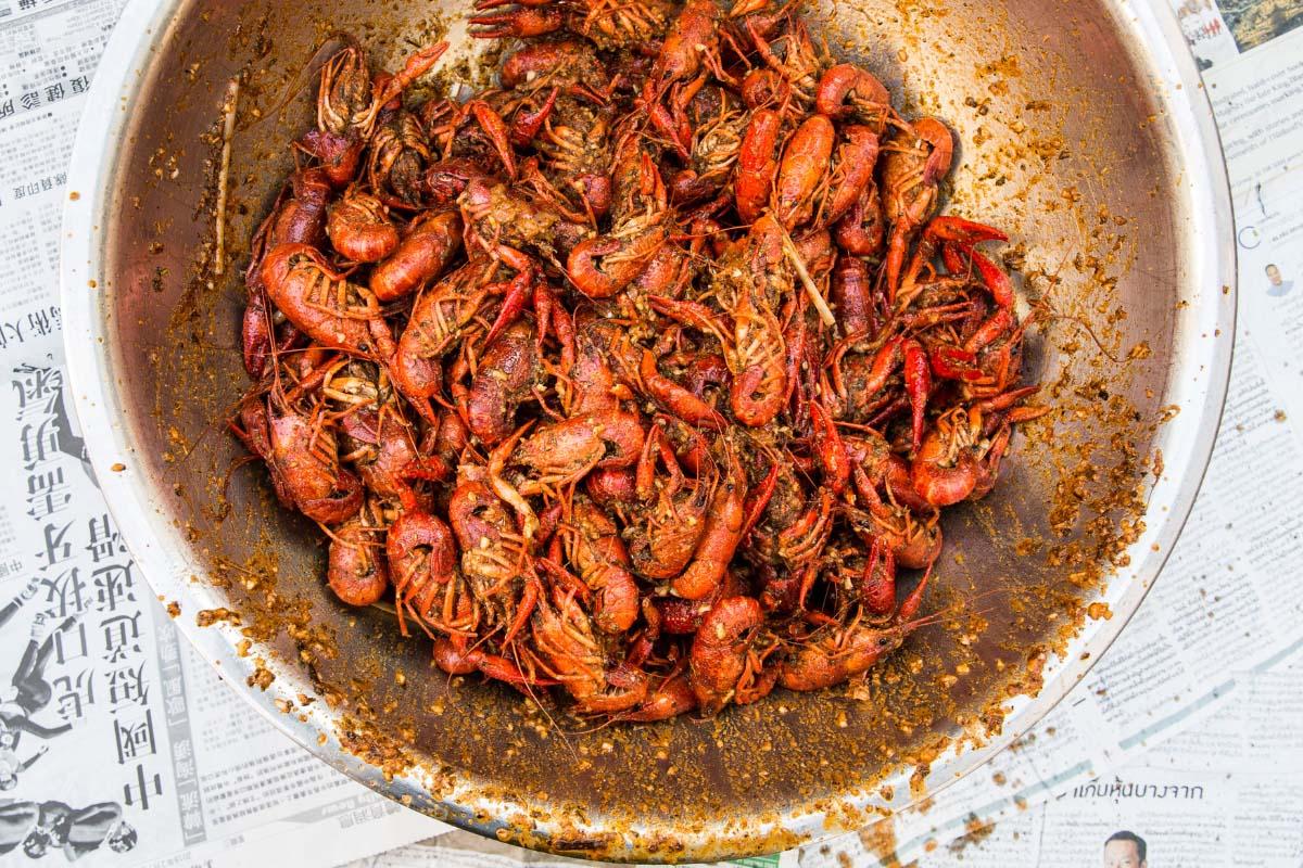 big bowl of boiled and seasoned crawfish