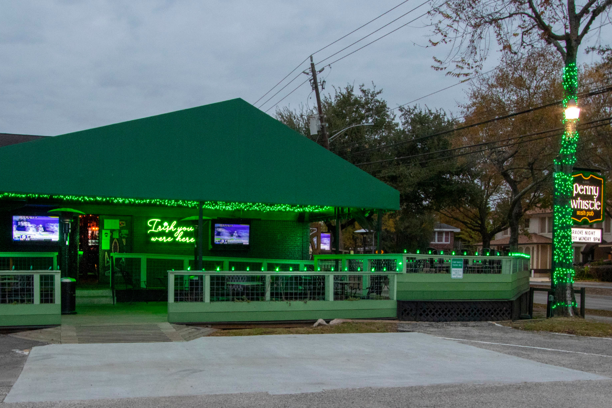Exterior of pub with green holiday lights