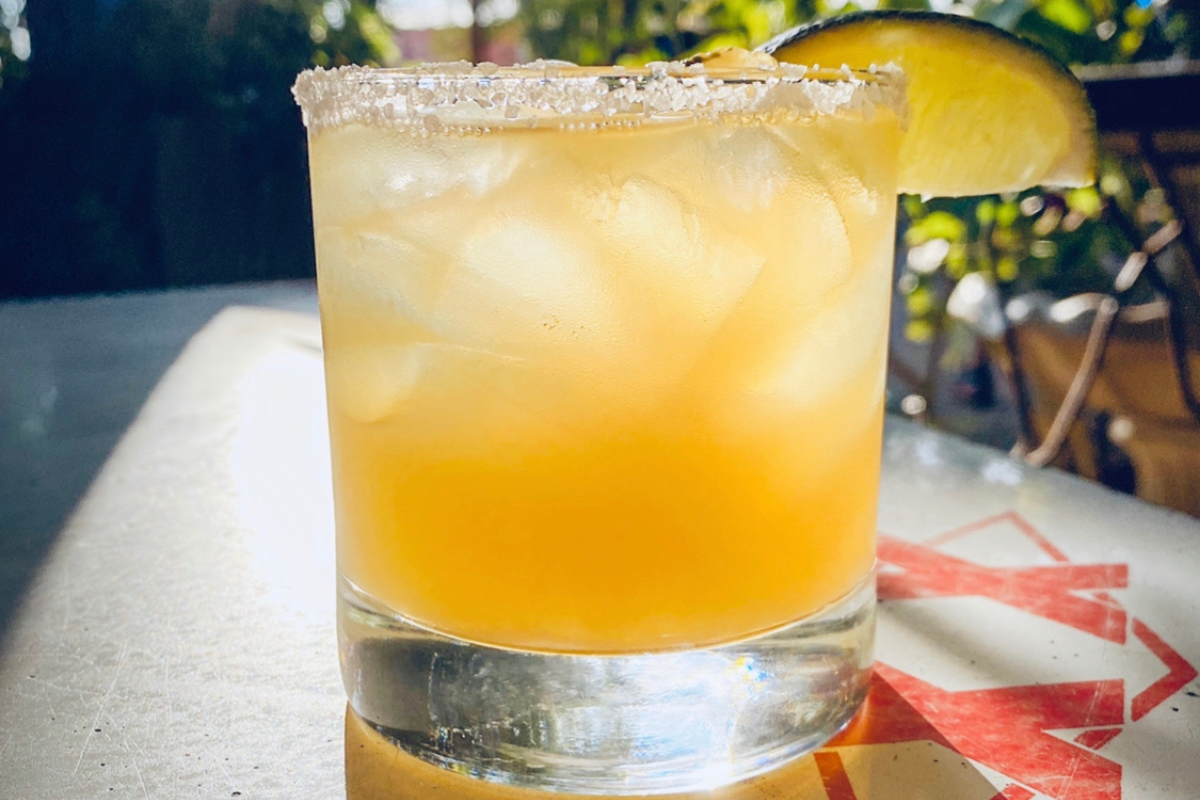 orange-colored margarita on the rocks