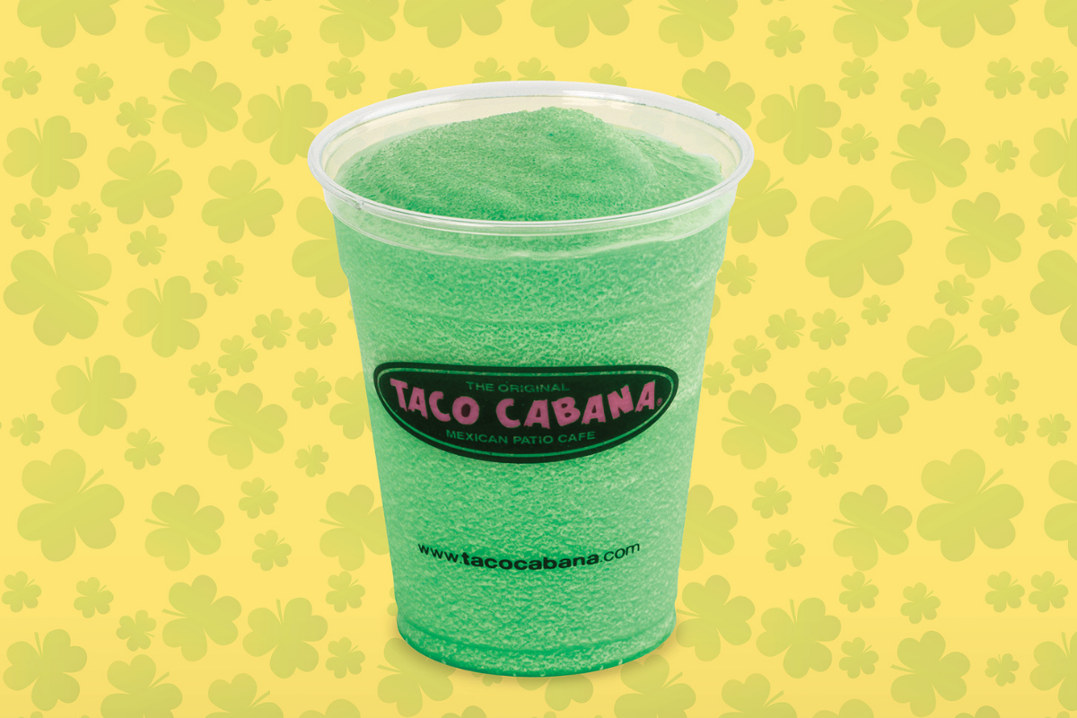 frozen bright green margarita in cup