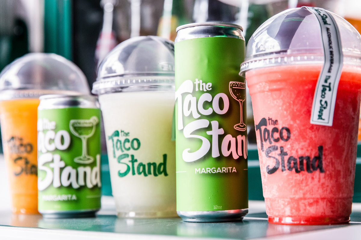 row of margaritas in cans and cups