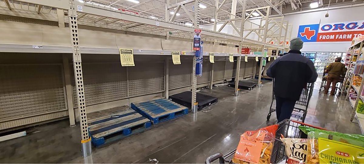 empty water shelves at H-E-B