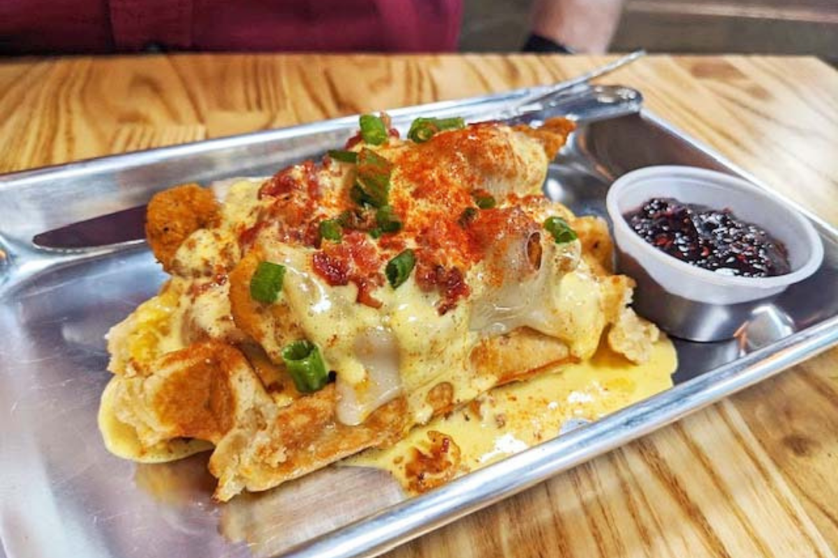 waffle topped with fried chicken and sauce