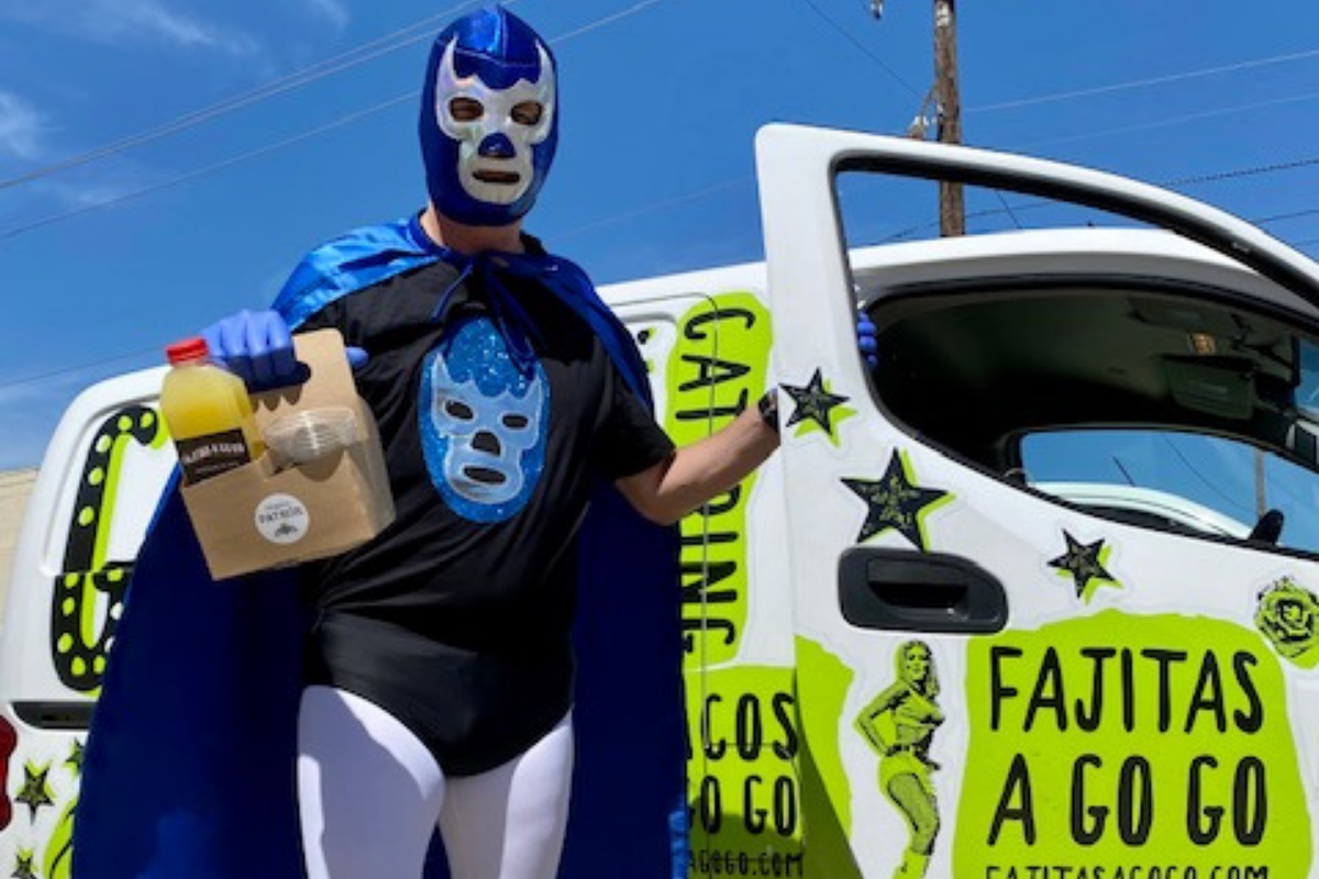 delivery driver in luchador costume