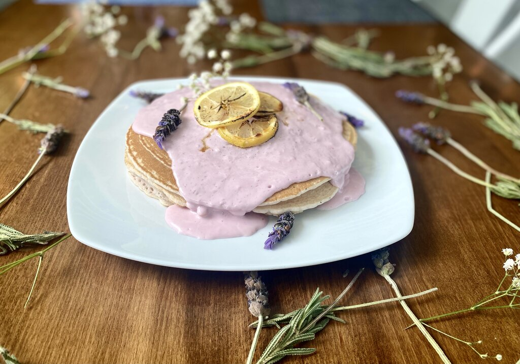 Photo of pancakes on a plate with a pink sauce