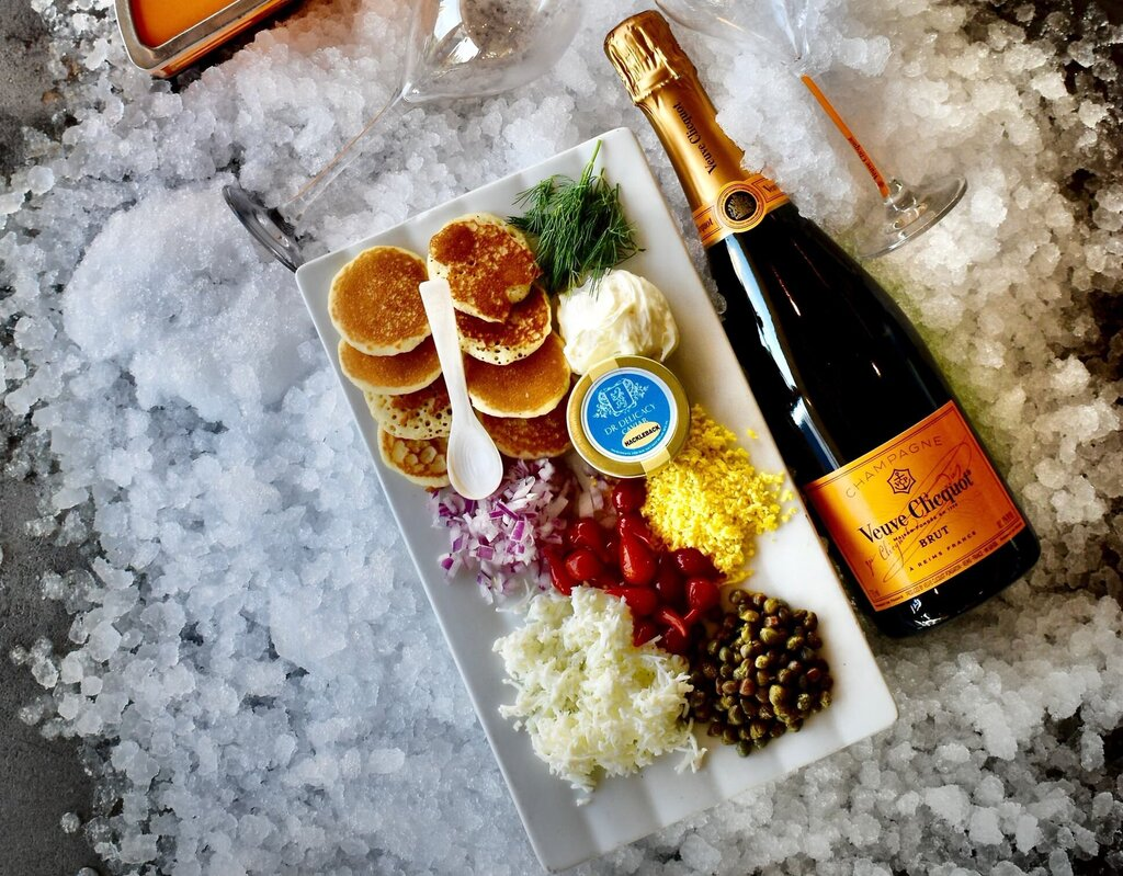 Caviar with egg and onion, and a bottle of Veuve Clicquot Yellow Label.