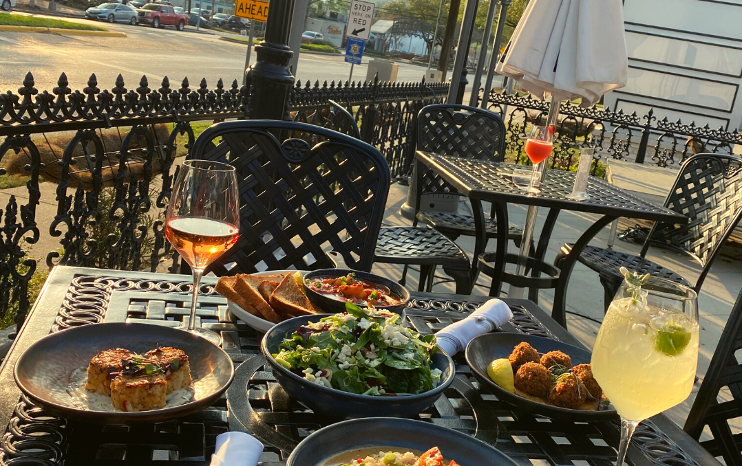 tables and plates of food on patio