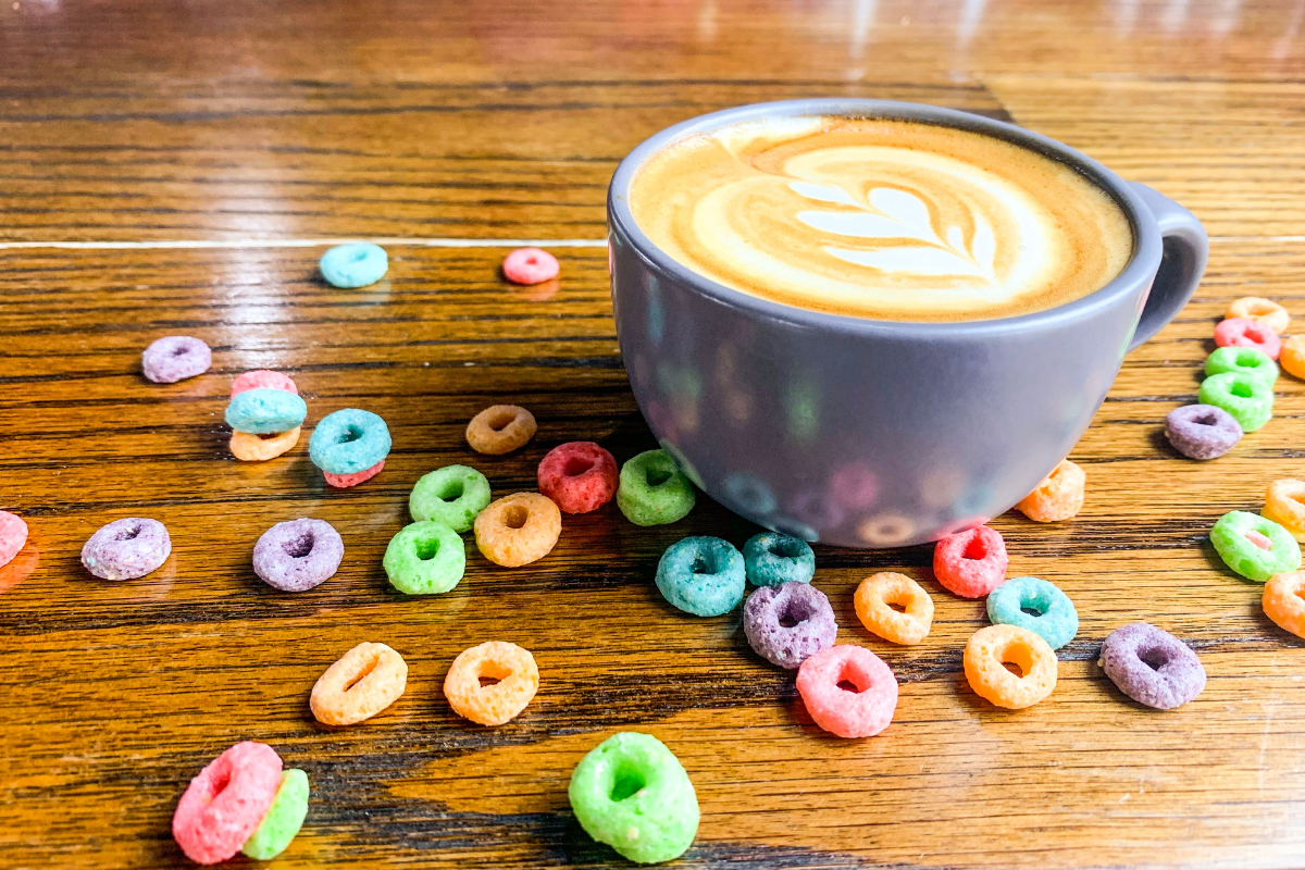 latte in mug with cereal scattered around it