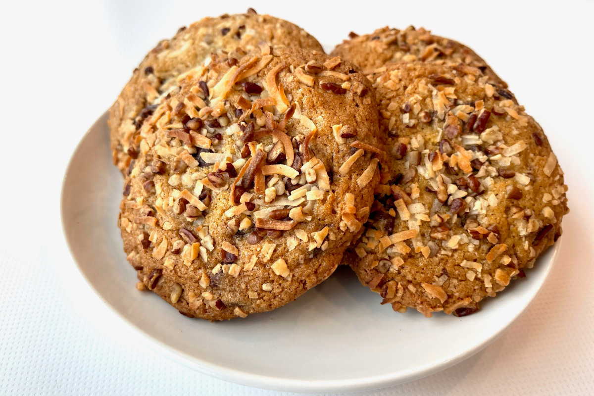 chocolate chip, nut, coconut cookies on a plate