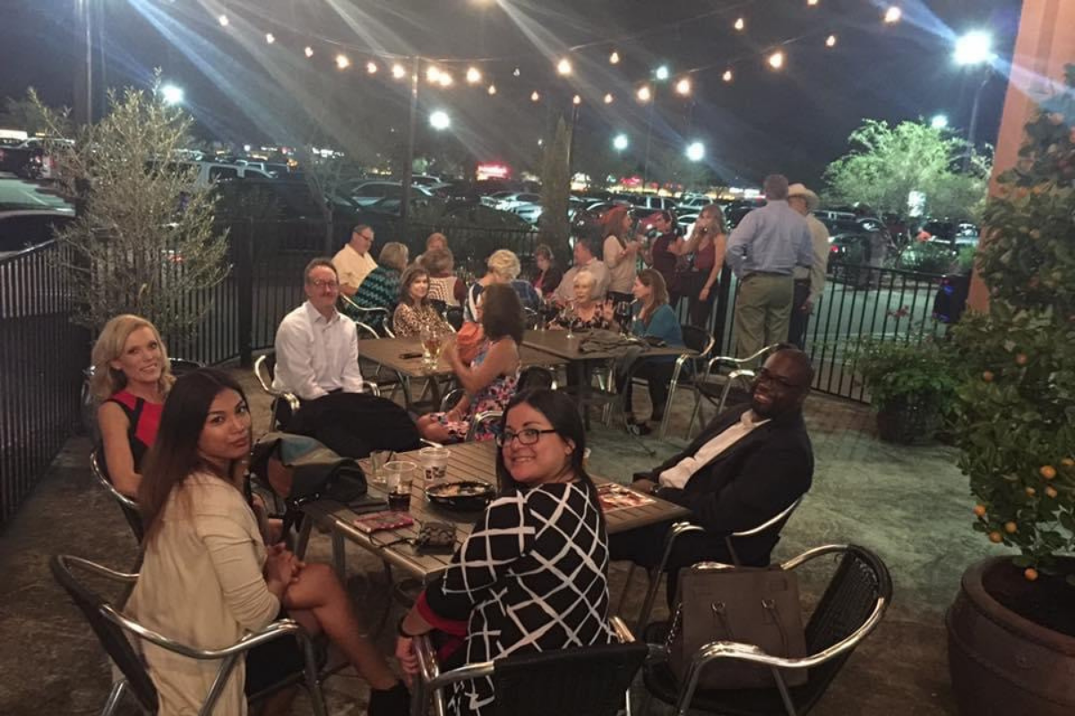 patio at night with people and string lights