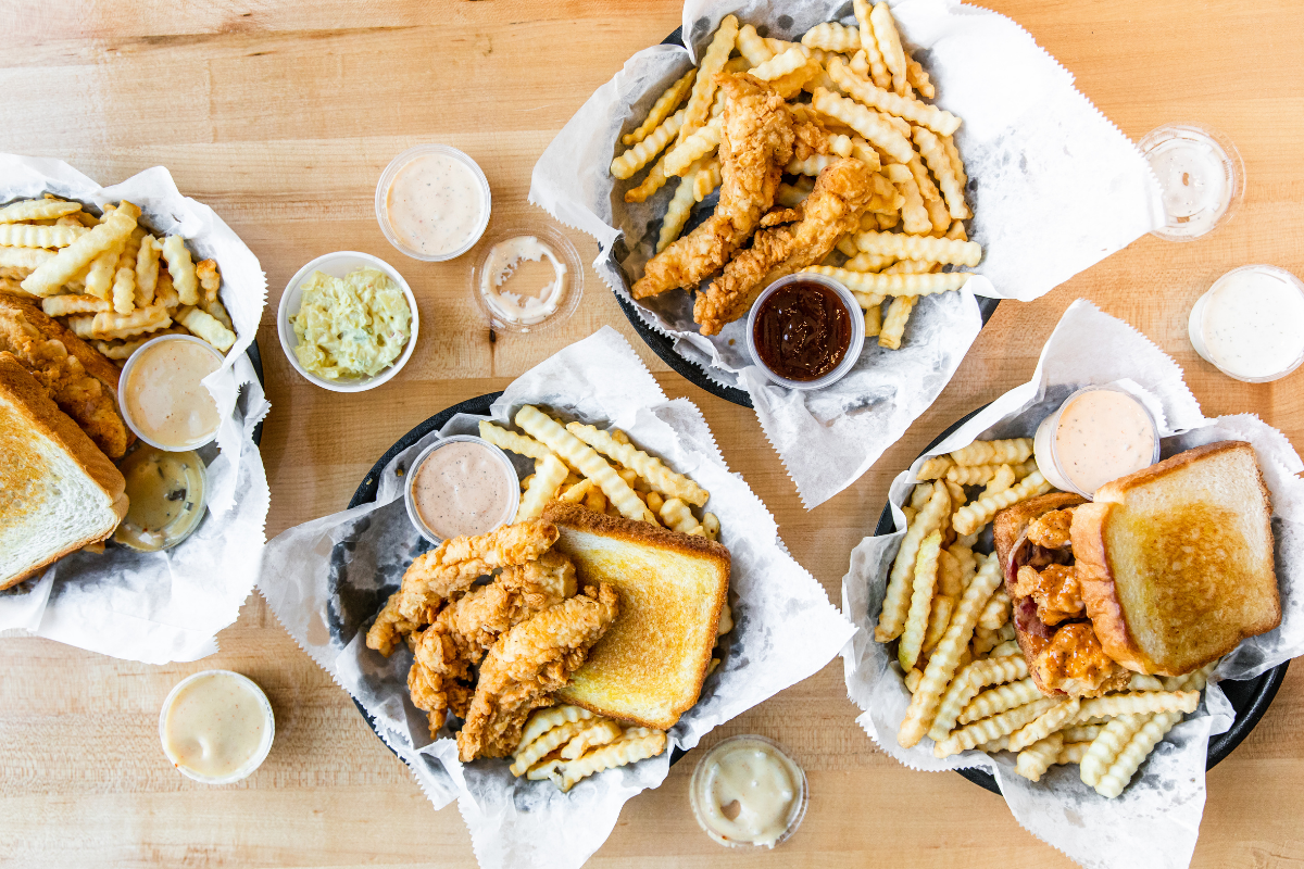 overhead view of fried chicken dishes