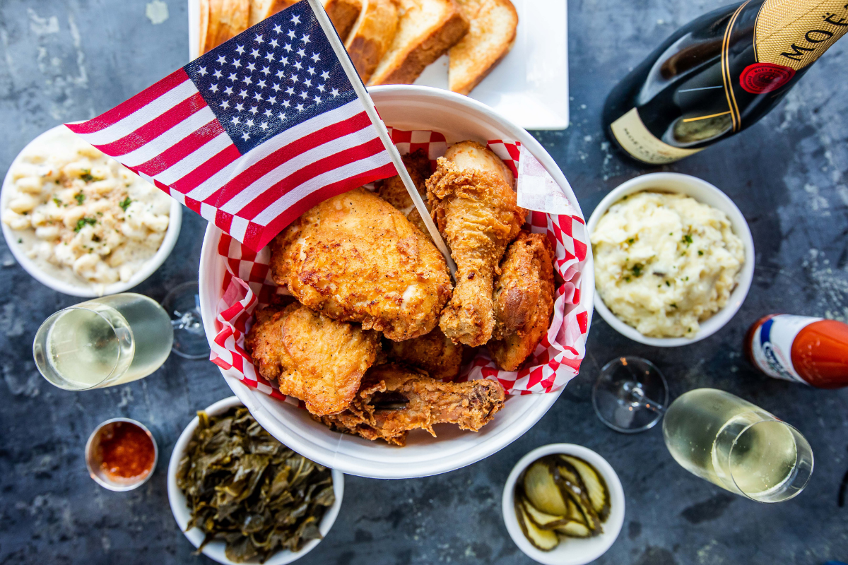bucket of fried chicken with sides and champagne