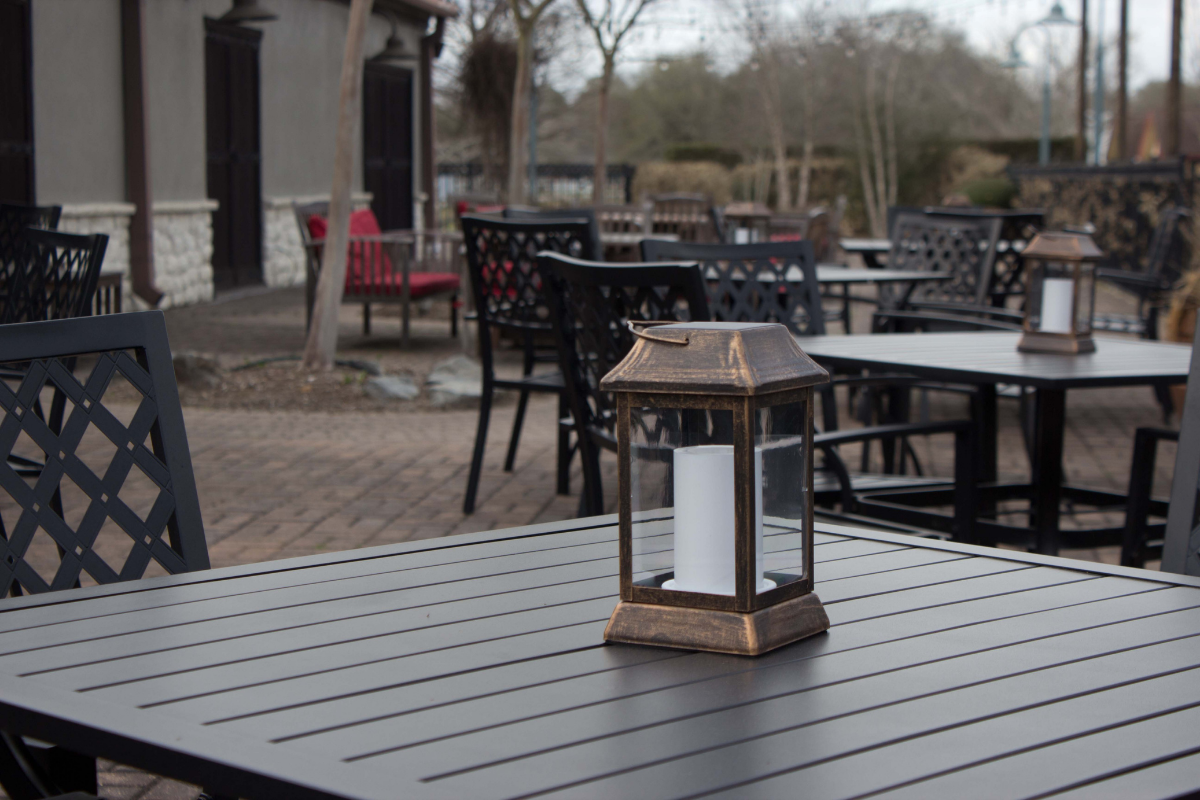elegant outdoor tables and lanterns on patio