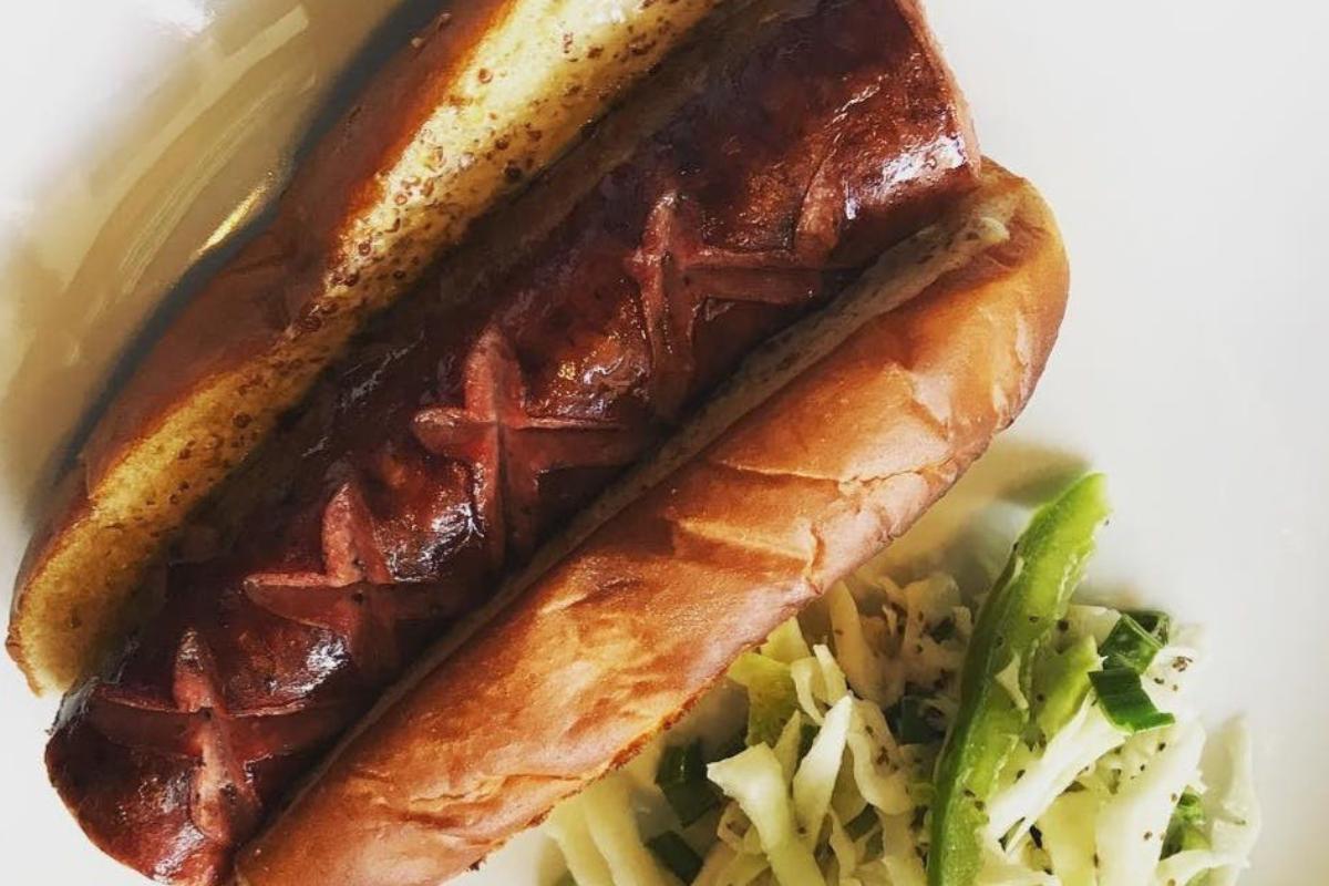large hot dog in bun