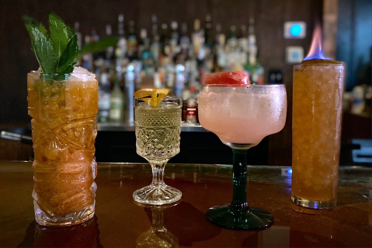 lineup of colorful cocktails