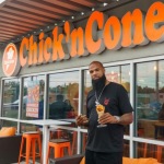 Rapper Slim Thug with chicken cone in front of restaurant