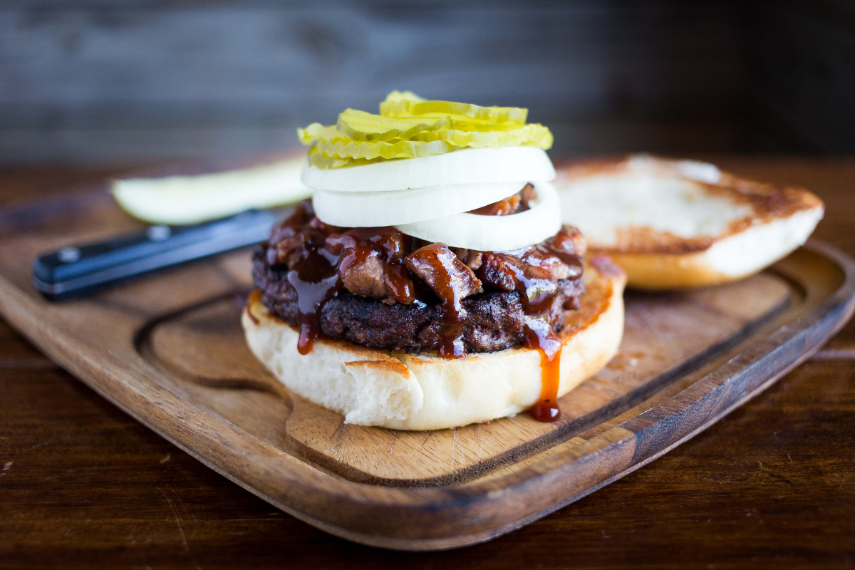 burger with brisket, onions and pickles
