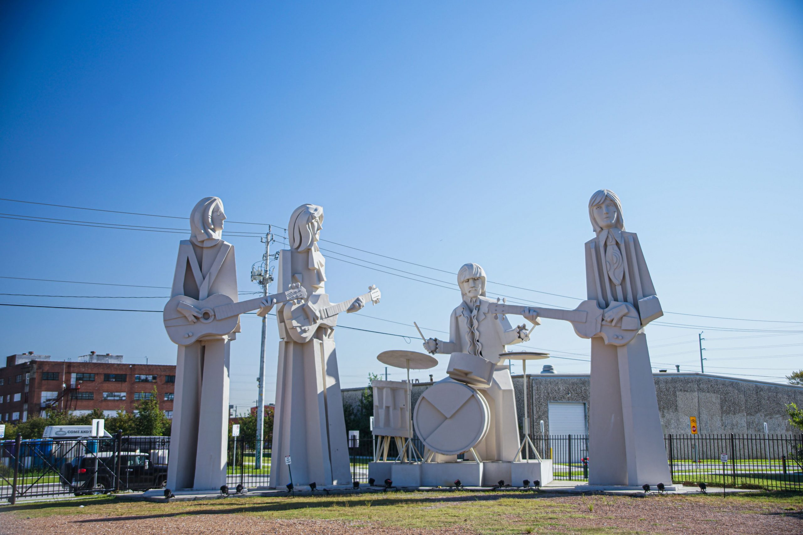 Giant Beatles statues on the grounds of 8th Wonder Brewery