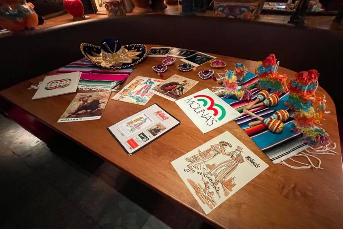 table with vintage Mexican menus and decor
