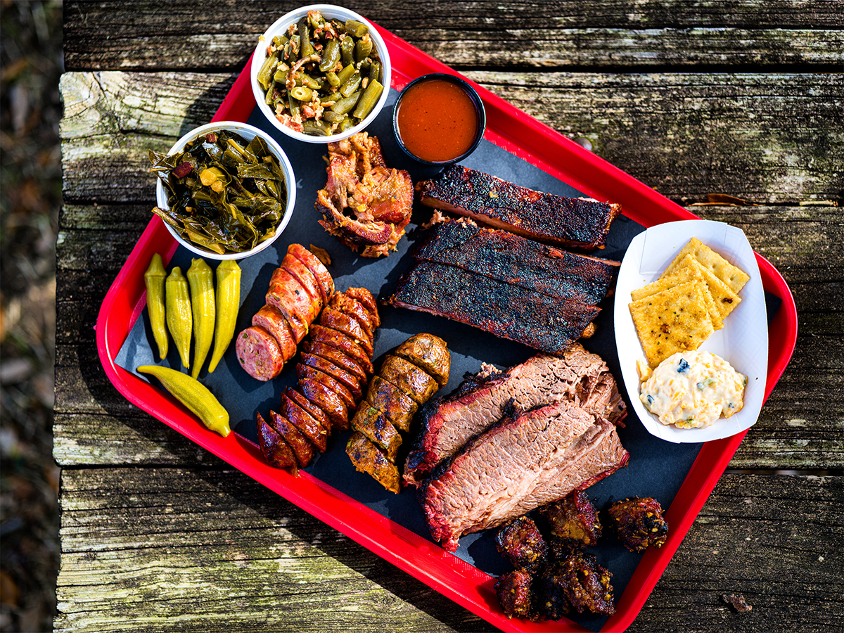 A tray of assorted barbecue and sides at Dozier's