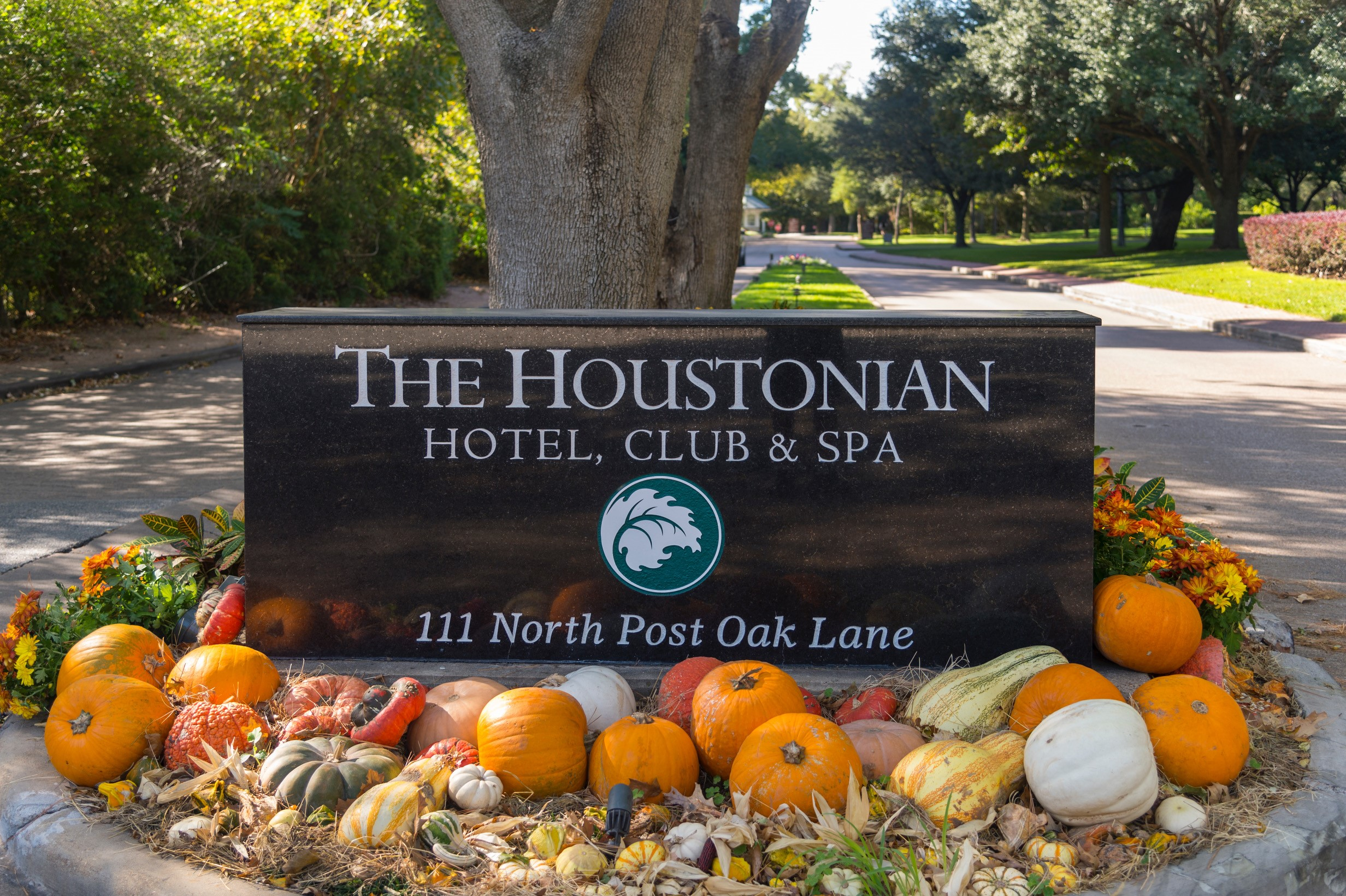 entrance sign to The Houstonian with pumpkins and fall decor