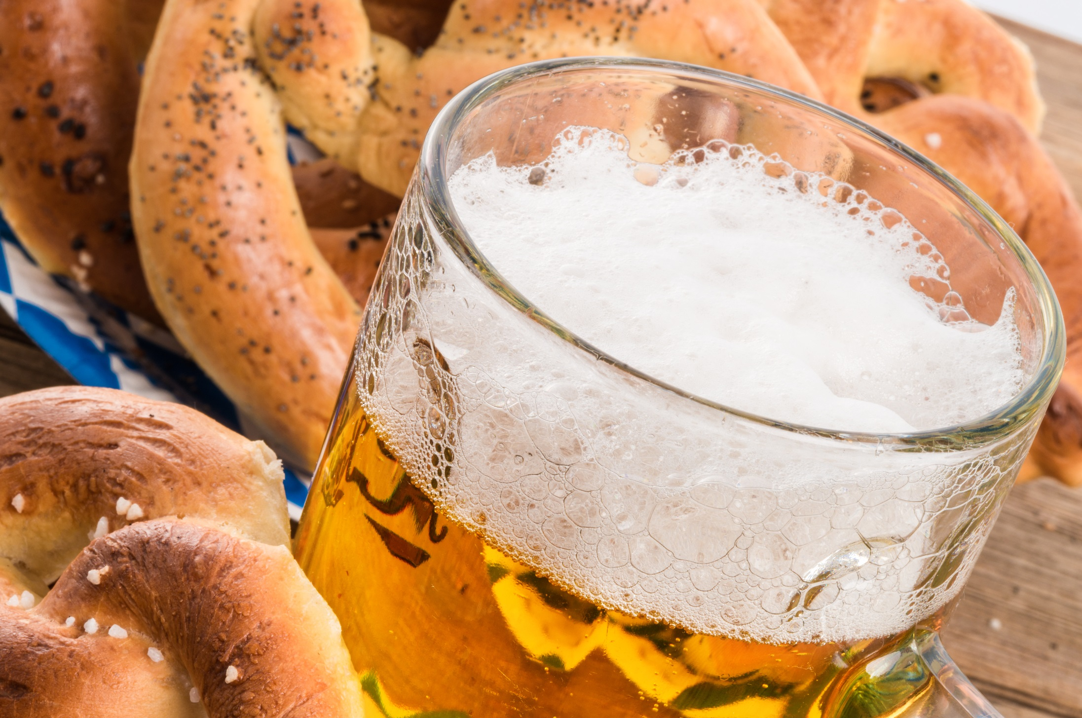 close-up of beer in stein with pretzels