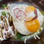 Chilaquiles with tomatillo salsa and sunny side up eggs